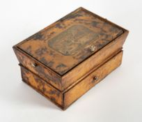 A REGENCY FAUX TORTOISE SHELL DECORATED SMALL WORKBOX with tapering sides, the lifting lid set