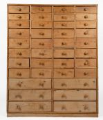 A PINE CHEST OF THIRTY EIGHT SPICE DRAWERS with turned knob handles, 92.5cm wide x 24cm deep x 115cm