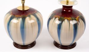 TWO PORCELAIN TABLE LAMPS of squat vase form, with a red, blue and cream striated glaze,