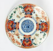 A 19TH CENTURY JAPANESE PORCELAIN IMARI CHARGER decorated with exotic birds, dogs of fo, plants