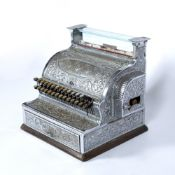 AN EARLY 20TH CENTURY CHROME PLATED AMERICAN NATIONAL CASH REGISTER with decorative casting and on a