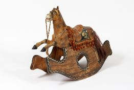 A 19TH CENTURY PAINTED PINE AND PAPIER MACHE ROCKING HORSE 101cm wide x 77cm high Condition: one ear