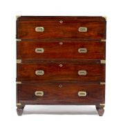 A MAHOGANY BRASS BOUND CAMPAIGN CHEST OF FOUR LONG DRAWERS the chest in two sections with iron