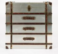 A DECORATIVE ALUMINIUM, LEATHER AND WOOD LATH BOUND CHEST with lifting lid to the top and three