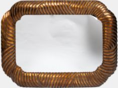 A LATE 20TH CENTURY SHAPED AND GILDED WALL MIRROR 116cm wide x 90cm high At present, there is no
