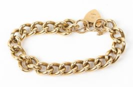 A 9 CARAT GOLD CURB LINK BRACELET with a 9 carat gold heart locket, 57 grams in weight Condition: in