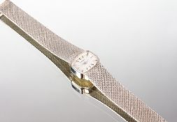 AN ETERNA 9 CARAT WHITE GOLD LADIES COCKTAIL WATCH with a 9 carat white gold strap and clasp, the