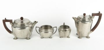 AN ART DECO STYLE 'MY LADY' ENGLISH HAMMERED PEWTER TEASET with Bakelite handles, the teapot 23cm