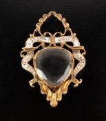 A 19TH CENTURY ROCK CRYSTAL AND ENAMEL MEMORIAL / SWEETHEART LOCKET PENDANT the scrolled openwork