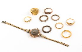 A COLLECTION OF EIGHT GOLD AND YELLOW METAL RINGS to include two 22k gold wedding bands, an 18 carat