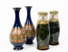 A PAIR OF DOULTON SLATER STONEWARE POTTERY BOTTLE VASES with flared rims, each 26cm in height