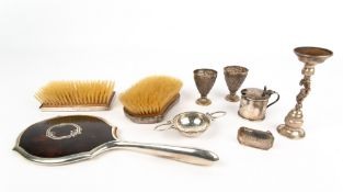 TWO SILVER BACKED BRUSHES, a silver and tortoise shell backed mirror, 29cm in length; a white