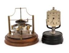 AN ART DECO STYLE ELECTRIC CLOCK by Tempex, 15cm wide x 23cm high together with a model of a clock