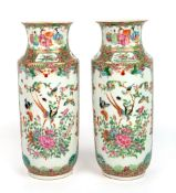 A PAIR OF LATE 19TH CENTURY CHINESE PORCELAIN FAMILLE VERTE CYLINDRICAL VASES decorated with figures