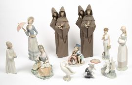 A COLLECTION OF LLADRO AND NAO PORCELAIN FIGURINES to include two Lladro monk figurines, each