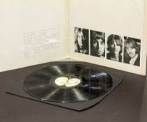BEATLES WHITE ALBUM numbered 0581648 inscribed to John Anthony Chester and signed by The Beatles,