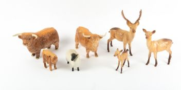 A GROUP OF SEVEN BESWICK PORCELAIN ANIMALS to include two Highland cows Condition: sheep with some