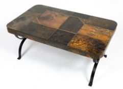 A TILE AND BRASS COFFEE TABLE with a wrought iron base, 100cm wide x 60cm deep x 44cm high