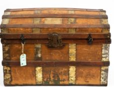 A LATE 19TH CENTURY AMERICAN DOME TOPPED TRUNK with leather handles and brass mounts, 84cm wide x