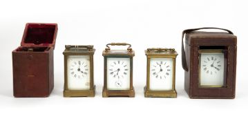 FOUR LATE 19TH / EARLY 20TH CENTURY GLASS CARRIAGE TIMEPIECES all with enamelled dials and roman