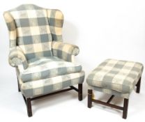 A LATE 20TH CENTURY UPHOLSTERED WING BACK ARMCHAIR 100cm wide x 90cm deep x 125cm high at the back x