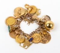 A 9 CARAT GOLD CHARM BRACELET with a 9 carat gold heart shaped locket and twenty three gold and