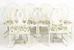 A SET OF SIX WHITE PAINTED FRENCH STYLE CONTEMPORARY KITCHEN CHAIRS the inset seats with brightly