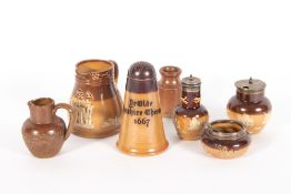 A ROYAL DOULTON STONEWARE SILVER TOPPED CRUET SET to include a pepperette 7.5cm in height, a salt
