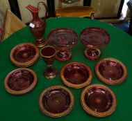 A SUITE OF VICTORIAN CRANBERRY GLASSWARE with gilt Greek key banded ornament consisting of a pair of