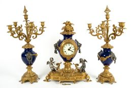 A LATE 20TH CENTURY GERMAN MADE FRENCH GARNITURE STYLE GILT METAL AND BLUE ENAMEL CLOCK with twin