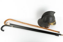 A 19TH CENTURY LEATHER FIREMAN'S HELMET 24cm wide x 27cm high together with an ebonised walking cane