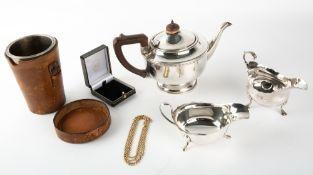 A GEORGE III SILVER SAUCE BOAT together with a 20th century silver sauce boat, combined weight of