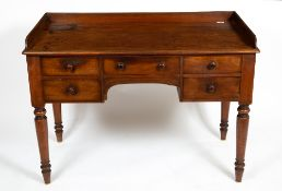 AN EARLY VICTORIAN MAHOGANY SIDE TABLE OR DESK with a galleried back, five drawers and turned