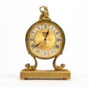 A LUXOR JARRARD FRENCH GILT METAL MANTLE CLOCK of circular form surmounted by a classical