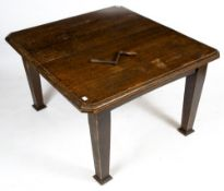 AN OAK WIND OUT EXTENDING DINING TABLE with canted corners and square tapering legs, complete with