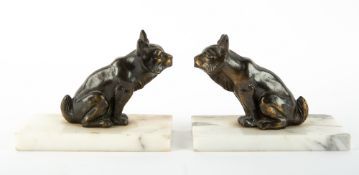 A PAIR OF MARBLE AND SPELTER BOOKENDS in the form of mythical beasts, each 13cm wide x 9.5cm high