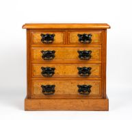 A WALNUT TABLE TOP MINIATURE CHEST OF TWO SHORT AND THREE LONG DRAWERS with burr walnut veneered