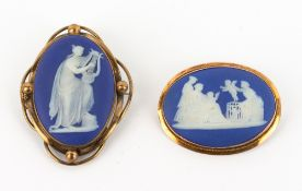 TWO 19TH CENTURY WEDGWOOD JASPERWARE BROOCHES with yellow metal mounts, one marked 9 carat, the
