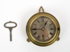 A LATE 19TH CENTURY BRASS SHIP'S CLOCK the silvered dial marked Hughes & Son Limited Opticians, 59