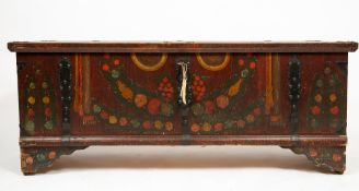 AN EARLY 19TH CENTURY PAINTED PINE CHEST with flower decoration and cast iron mounts, 153cm wide x