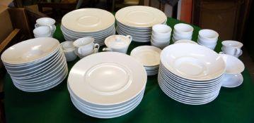 A FRENCH BERNARDAUD LIMOGES WHITE PORCELAIN PART DINNER SERVICE consisting of thirteen bowls, 25.5cm