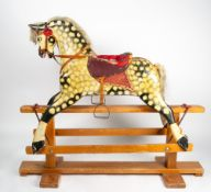 AN EARLY 20TH CENTURY PAINTED PLASTER AND WOOD ROCKING HORSE mounted on a pine frame, overall