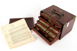 AN EARLY 20TH CENTURY BONE AND BAMBOO MAHJONG SET in a brass and hardwood mounted six drawer