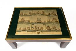 A BRASS BOUND HARDWOOD COFFEE TABLE with a glazed top inset with a copy of an 18th century naval
