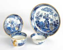 AN EARLY 19TH CENTURY WEDGWOOD PORCELAIN TEA CUP, SAUCER AND PLATE with blue, white and gilded