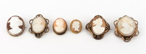 A GROUP OF SIX ANTIQUE CAMEO BROOCHES the largest 3.5cm x 5cm Condition: frames not precious