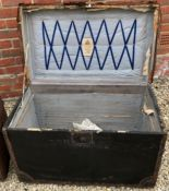 AN ANTIQUE IRON AND LEATHER BOUND TRUNK