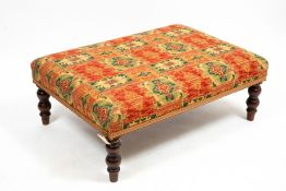 A LARGE MODERN UPHOLSTERED FOOT STOOL with four turned legs, 102cm wide x 72cm deep x 36cm high
