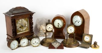 AN ANTIQUE GERMAN WALNUT CASED MANTLE CLOCK by RSM, the brass and silvered dial with roman numerals,