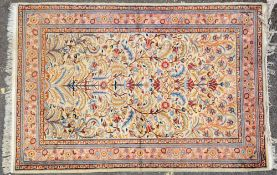 AN ORIENTAL YELLOW GROUND FLORAL RUG with multiple banded border, 190cm x 128cm Condition: some